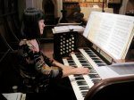 Kathy Au Crosier plays the organ at Regnal Hall's memorial service.