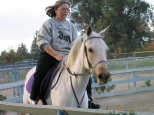 Kathie Benno rides one of her horses.