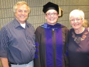Proud parents, Norm and Pat Sabin, with daughter Daris